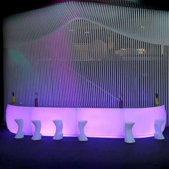 Fiesta RGB LED Light Bar (pink light shown here). Bar Counter created with the 2 Fiesta modules by Vondom