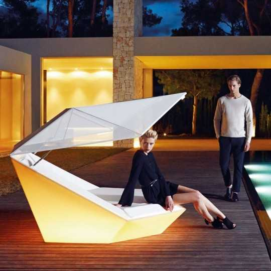 Giant RGB Lighting Faz Daybed with Parasol on a Hotel Poolside